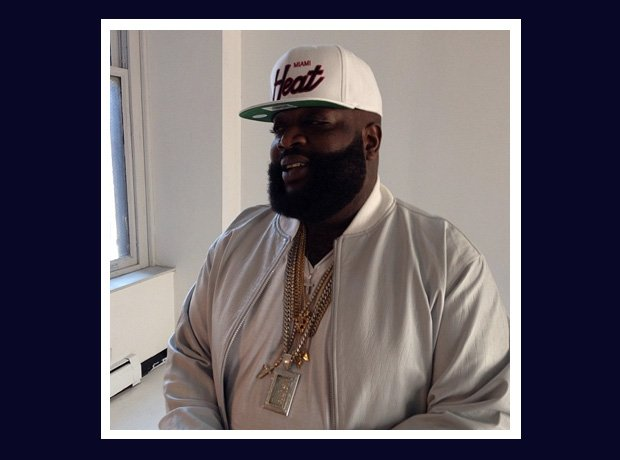Rick Ross wearing a Miami Heat cap