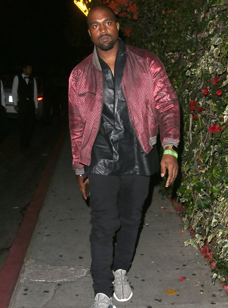 Kanye West on a night out wearing a metalic jacket