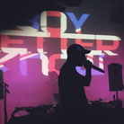 Skepta in front of British BBK sign