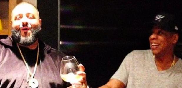 Dj Khaled receives Roc A Fella chain from Jay Z