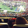Image 10: Beyonce and Blue Ivy sitting at american football