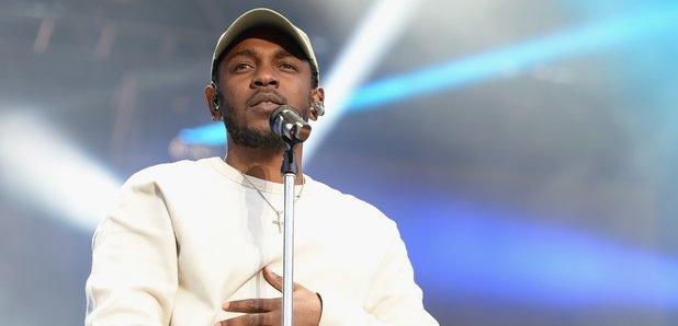 Kendrick Lamar performing on stage