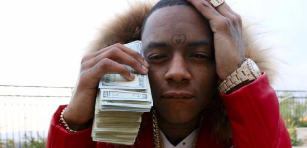 Soulja Boy holding stack of money