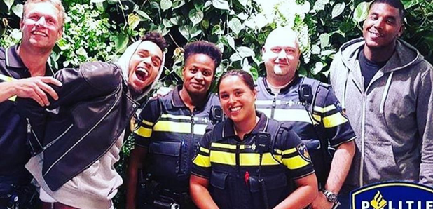 Chris Brown with police in Amsterdam