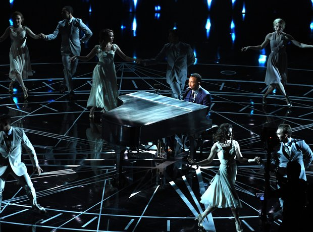 John Legend performs on stage at the Oscars 2017